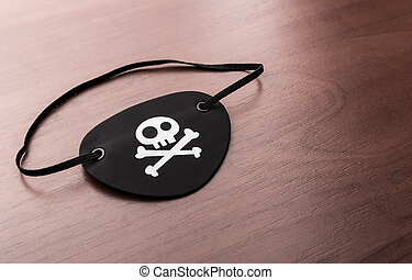 Pirate eyepatch on the table - A closeup of pirate eyepatch...