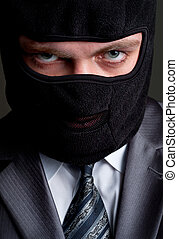Businessman in black balaclava - Business crime. Businessman...