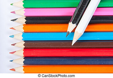 Color pencils with black and white on top