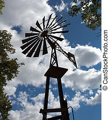 Old-fashioned windmill - Silhouette of old-fashioned farm...