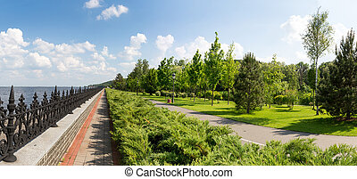 Park near the sea - Green park with conifers and stone...