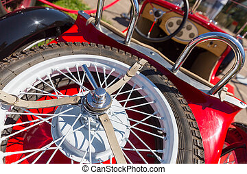 Spare wheel of retro car - Spare wheel on a red retro car...