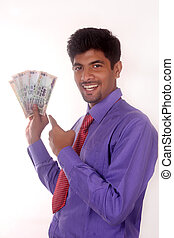 Businessman holding indian money - business man holding...