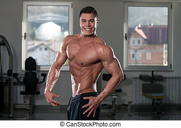 Man In Gym Showing His Well Trained Body - Portrait Of A...