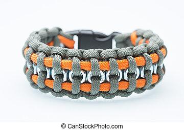 Black braided bracelet on white background.  synthetic cord