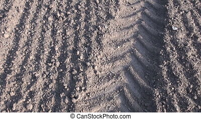plowed field with tractor tracks - Landscape with freshly...