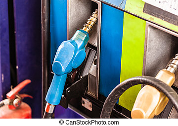 petrol gas pump - colored petrol gas pump nozzles in a...