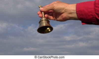 Hand holding beautiful brass bell - Hand holding beautiful...
