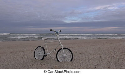 toy bicycle on the beach by sea
