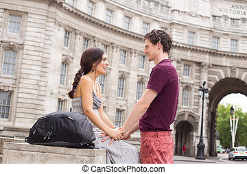 romantic couple - young couple in the street chatting