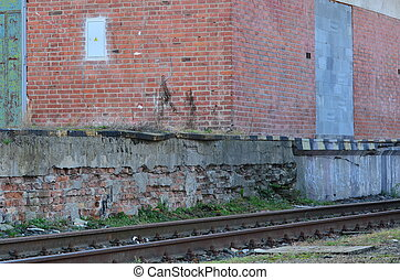 An old railway depot with railroad line