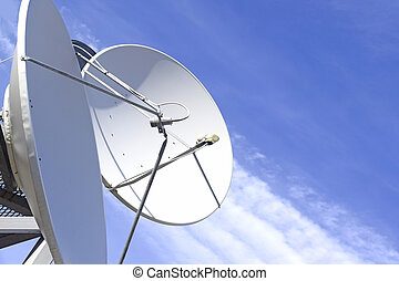 Satellite dish and antenna on blue sky background