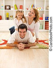 Happy family in the kids room