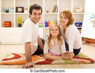 Happy family together sitting on the floor
