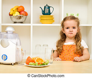Little girl making faces - fruit juice again ?