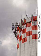 Phone tower - Photo of a high red and white phone toower