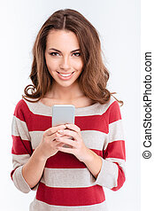 Smiling woman using smartphone - Portrait of a smiling woman...