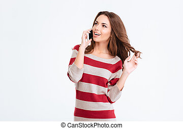 Cheerful woman talking on the phone and looking away -...