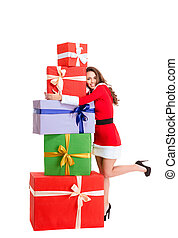 Happy woman in santa claus cloth hugging many gift boxes -...