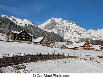 Winter scene in the Toggenburg valley, mountain and traditional architecture