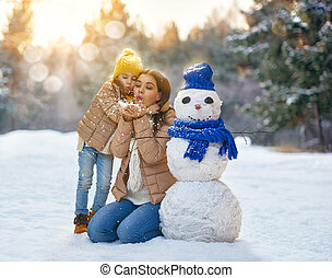 Mother and child girl on a winter walk - Happy family!...