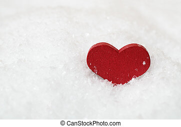 Red Heart in Snow - A red wooden heart, nestled in white...