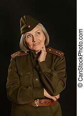 Elderly female soldier on a black background