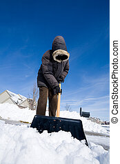 Snow day - Man is shoveling snow from the driveway