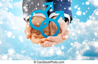 close up of male gay couple holding gender symbol