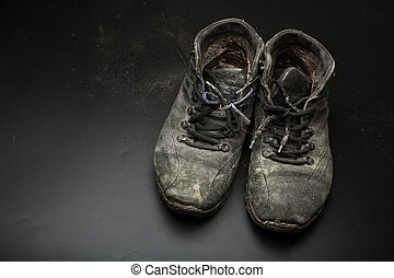 Old worn out shoes on the floor