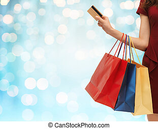 close up of woman with shopping bags and bank card - people,...