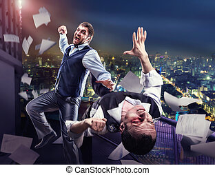 Businessmen fighting - Two businessmen fighting on the roof...