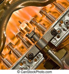 Burner of gas boiler on work. Inside the boiler