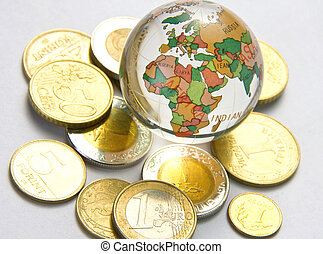 World globe and different coins