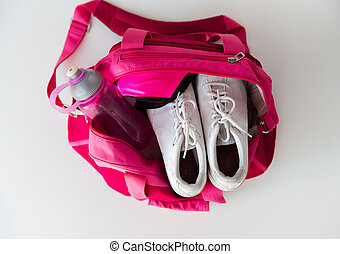 close up of female sports stuff in backpack - sport,...