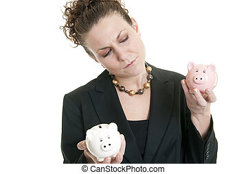 Comparing savings - Attractive Caucasian female holding a...