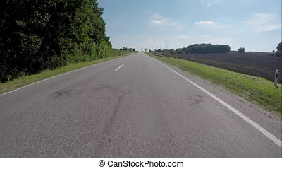 Driving on the highway near the forest