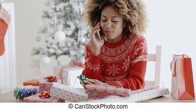Young woman chatting on her mobile at Christmas - Young...