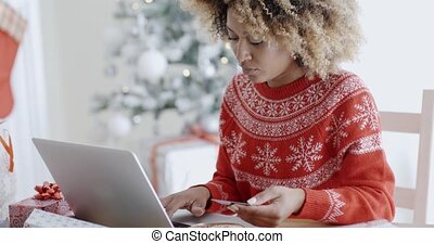 Young woman doing Xmas shopping online - Young trendy...
