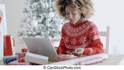 Young woman doing Xmas shopping online
