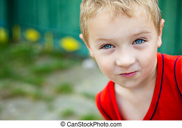 Portrait of cute expressive funny boy