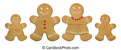 Gingerbread family - Smiling gingerbread family stand in a...