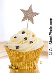 Golden cupcake - Cupcake decorated with gold dragees and...
