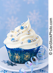 Cupcake with a winter theme against a snowflake background