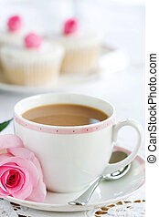 Afternoon tea - Cup of tea served with a rose and cupcakes