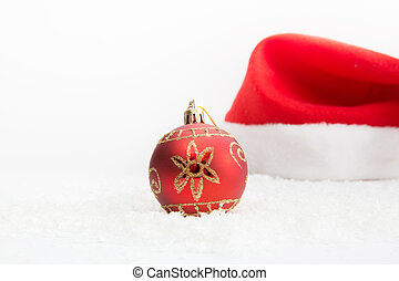 Christmas balls on white background with hat - Santa hat...