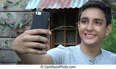 Hispanic Teen Taking Selfie