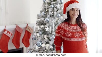 Pretty young woman celebrating Christmas at home