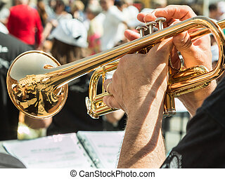 Beard Man Playng Brass Lacquered Trumpet during Outdoor...