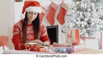 Young woman making a Christmas greeting call